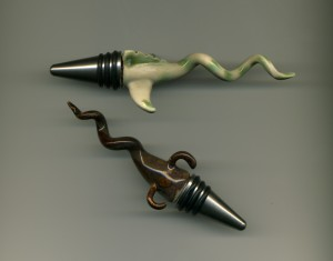 Wine stoppers with Curly Creature tops